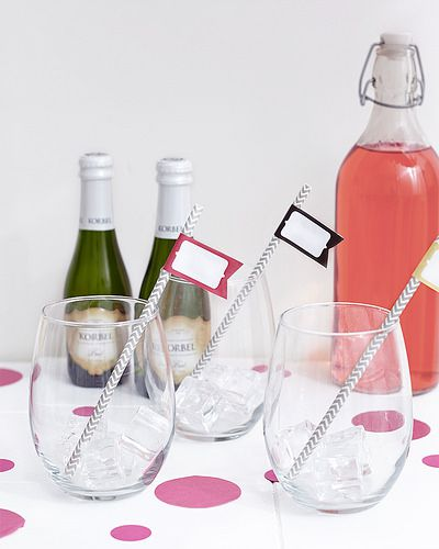 stemless wine glasses with champagne and pink lemonade and cocktail stirrers with little flags